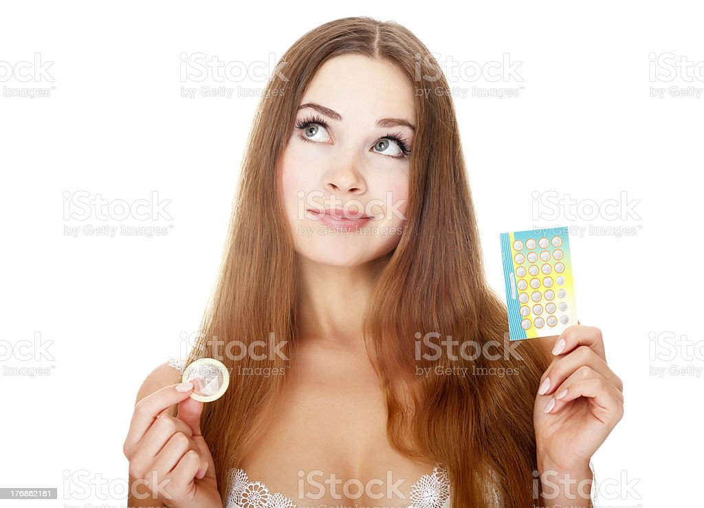 Girl with contraceptives stock photo