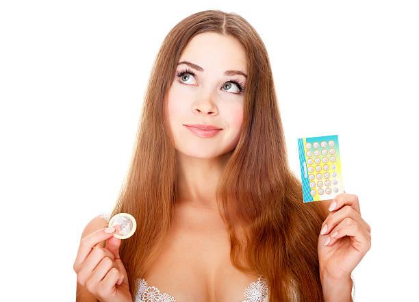 menina com contraceptives - planejamento familiar - fotografias e filmes do acervo