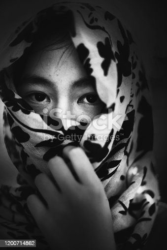 Girl with cover in white tone, abuse concept
