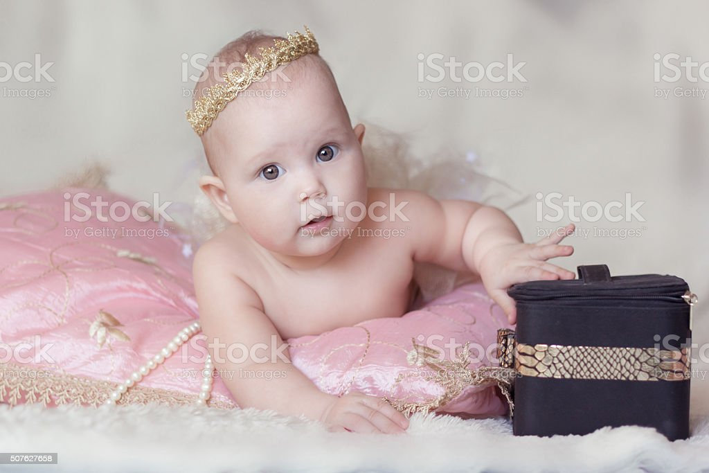Girl with crown and boxes stock photo