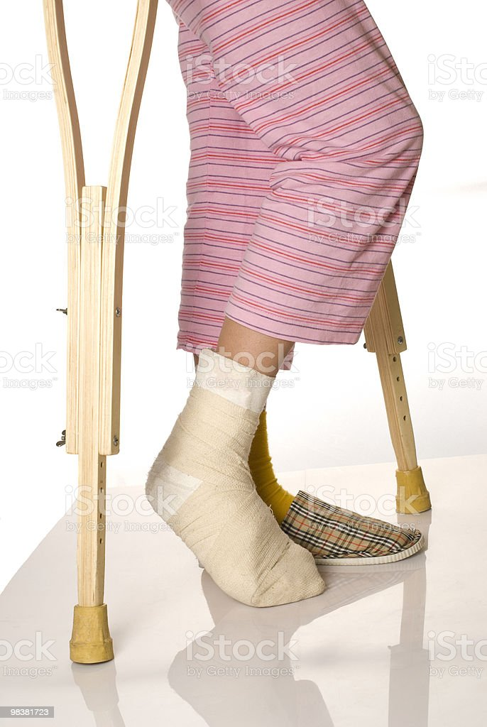 Girl with crutches royalty-free stock photo