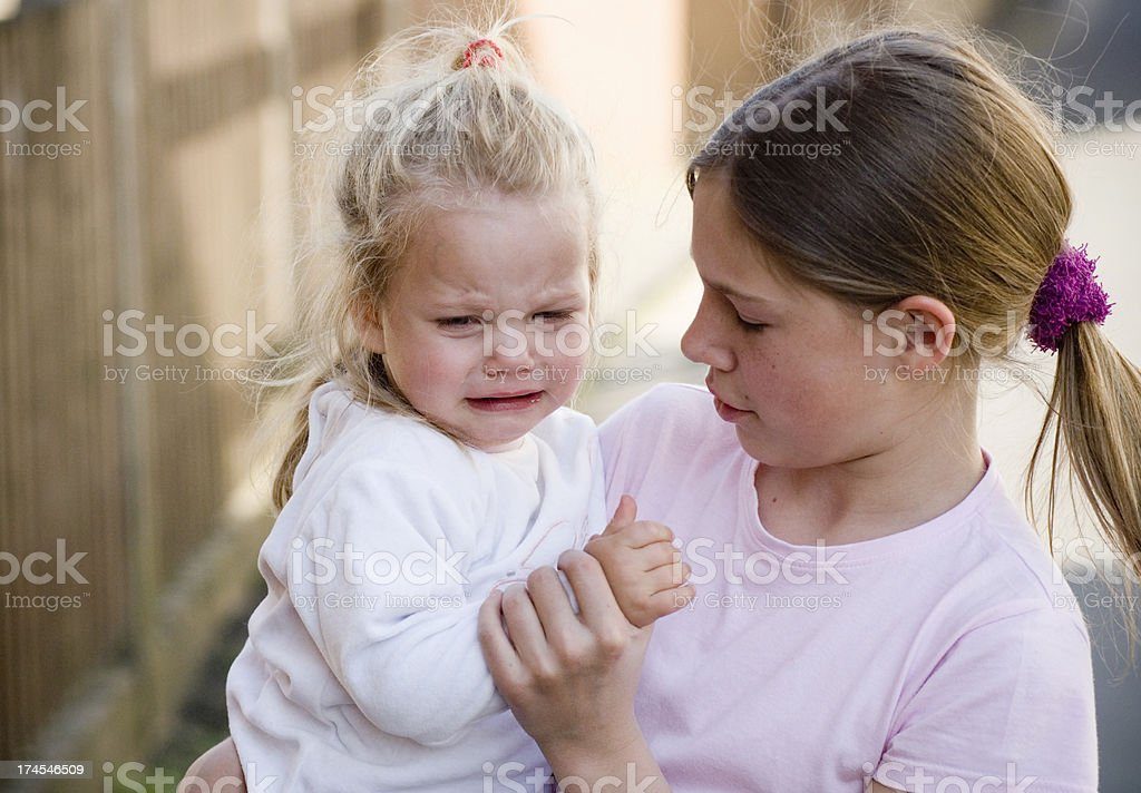 Girl with crying sister royalty-free stock photo