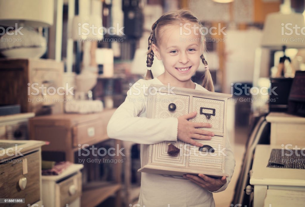 girl with curbstone in furniture store stock photo