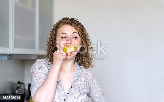 Girl With Curly Hair Eating Pear Young Woman Eating Fruit - Stockowe zdjęcia i więcej obrazów Fotografika
