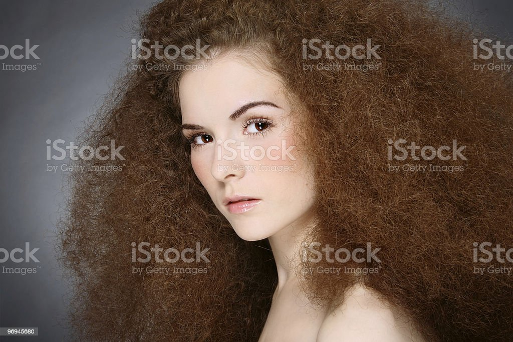 Girl with curly hair royalty-free stock photo