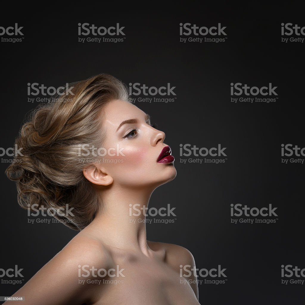 Girl with dark lips and hairdo royalty-free stock photo