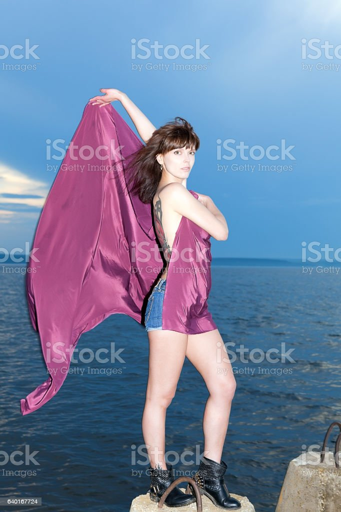 girl with developing purple dress stock photo