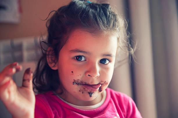 girl with dirty mouth - kinderschokolade stock-fotos und bilder
