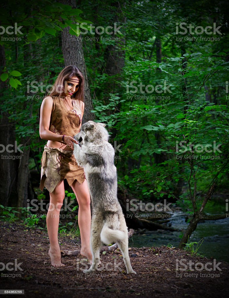 https://media.istockphoto.com/photos/girl-with-dog-at-forest-picture-id534363255