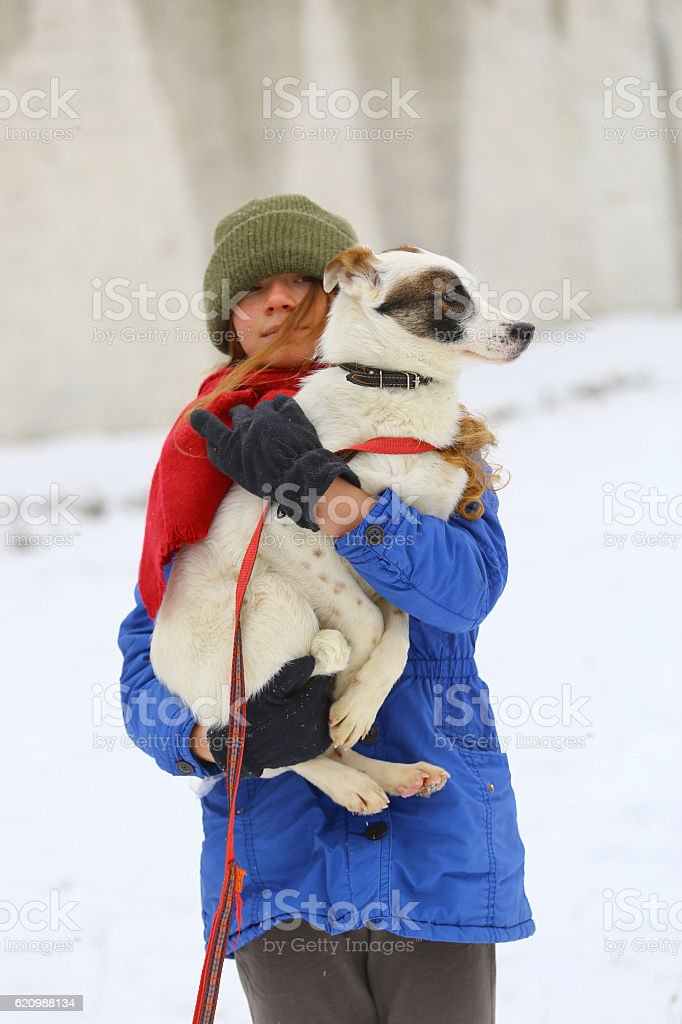 Girl with dog in winter park foto royalty-free