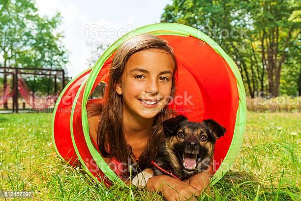 Girl with dog play in playground tube picture id512457297?b=1&k=6&m=512457297&s=612x612&h=hbbu2sfxdmc98 zabsl9ndf3poxffslsux3ow9gkl94=