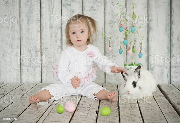 Girl with down syndrome holding the ear easter bunny picture id485926761?b=1&k=6&m=485926761&s=612x612&h=kb fwoy90uqago vfnoisk5eaj mdwcibpkbhjmeetu=