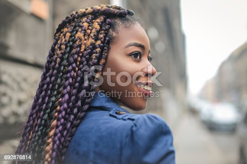 624206636 istock photo Girl with dreadlocks 692876814
