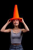 Girl with dunce hat on head
