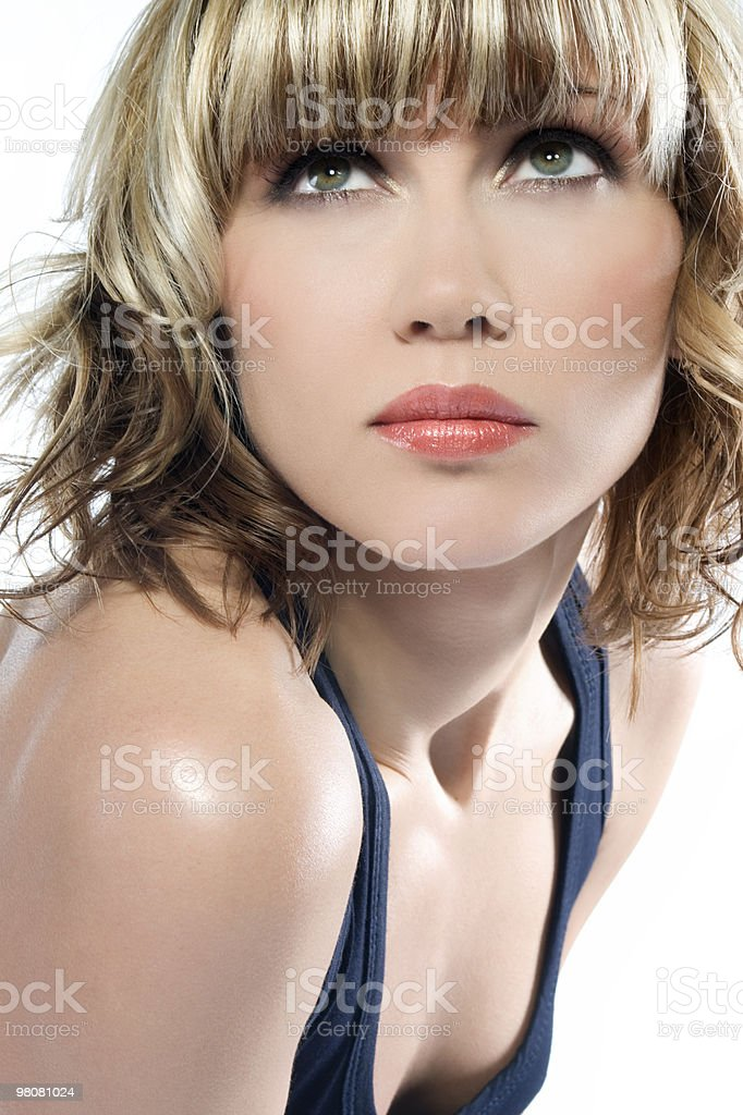 A girl with dyed hair looking upwards royalty-free stock photo