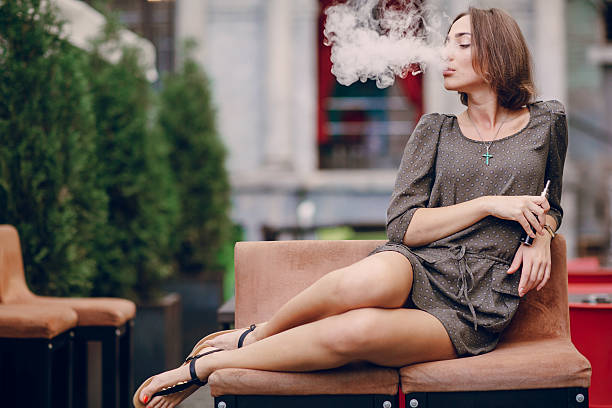 girl with E-cigarette stock photo