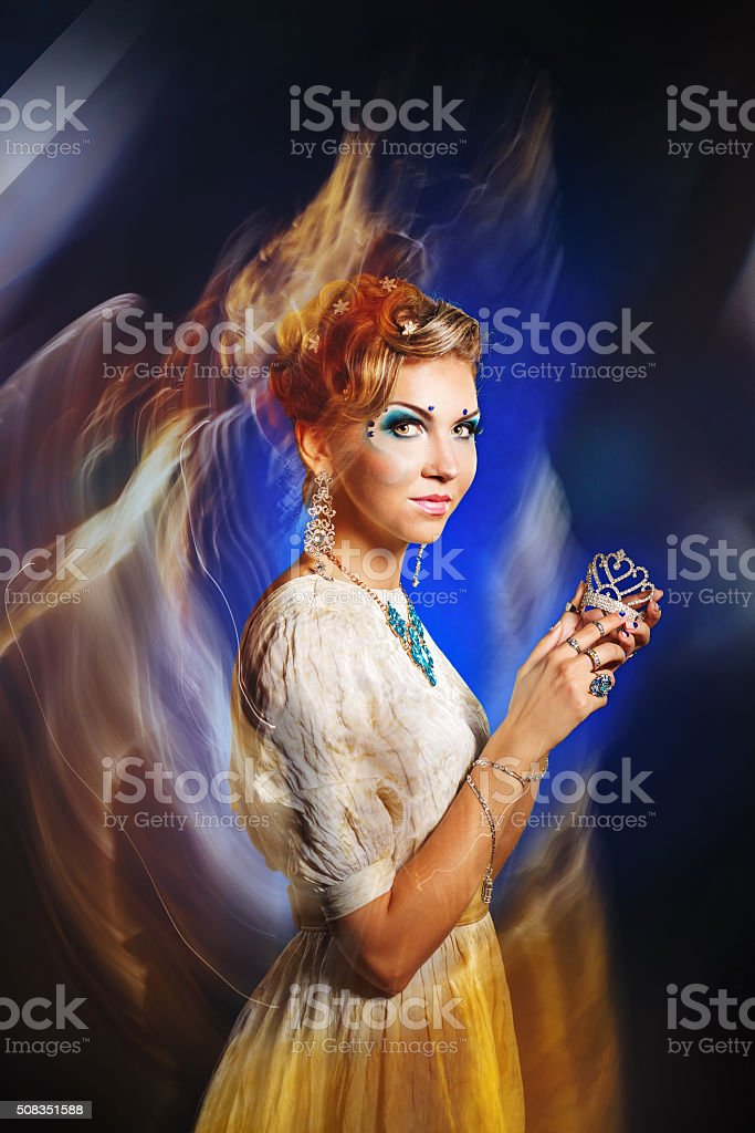 Girl with face art, jewelry and hairdo. stock photo