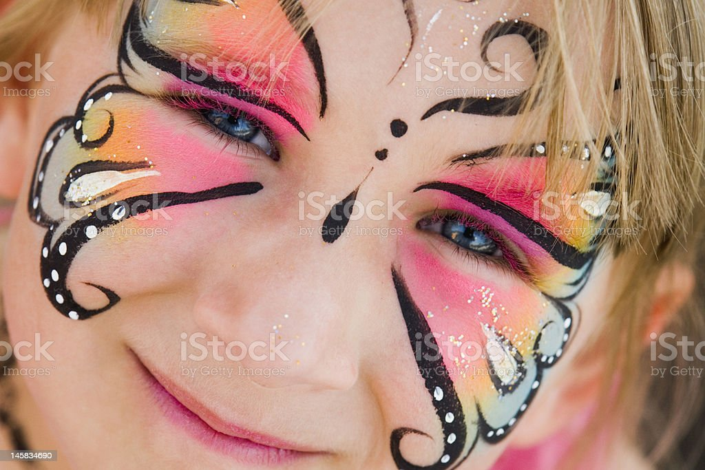 Girl with face painted stock photo
