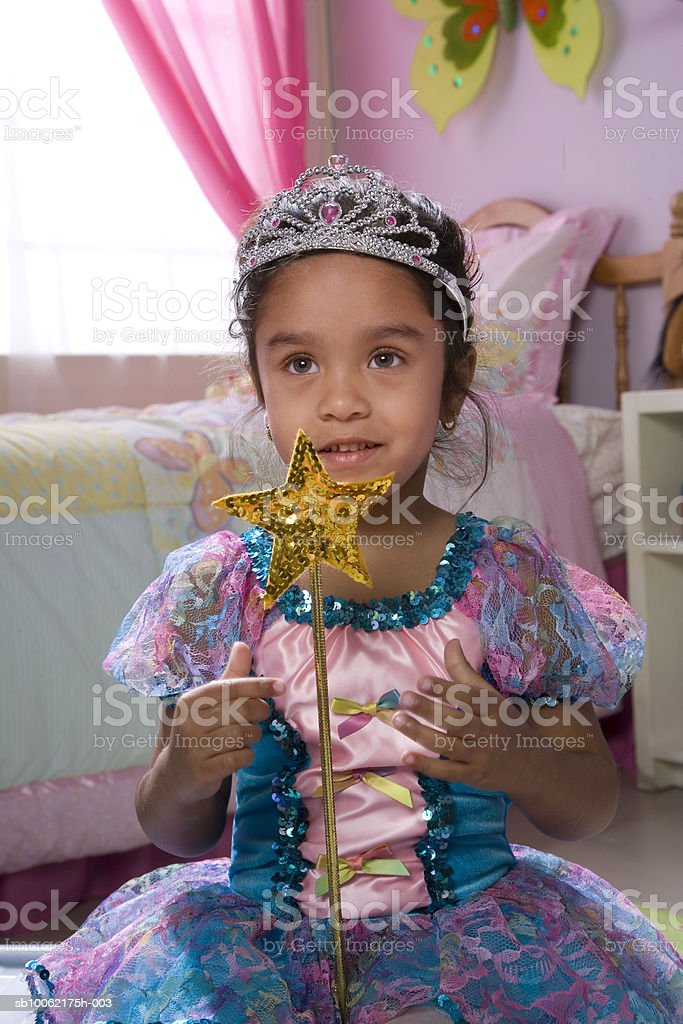Girl (4-5) with fairy costume and magic wand 免版稅 stock photo