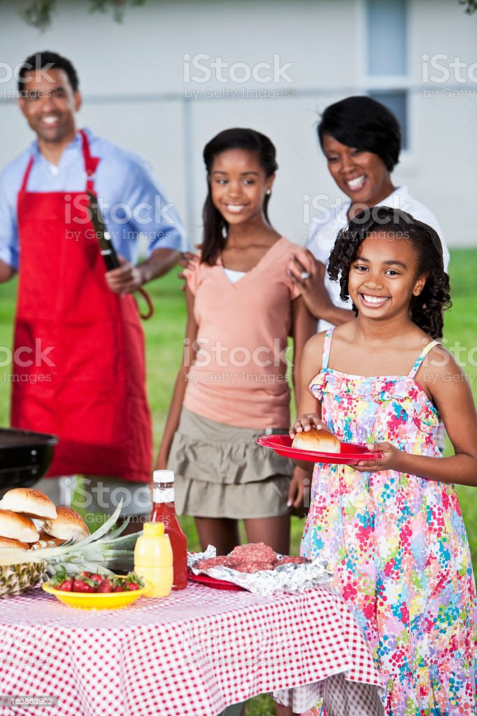Girl with family at cookout royalty-free stock photo