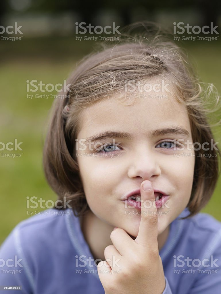 Girl with finger to mouth Lizenzfreies stock-foto