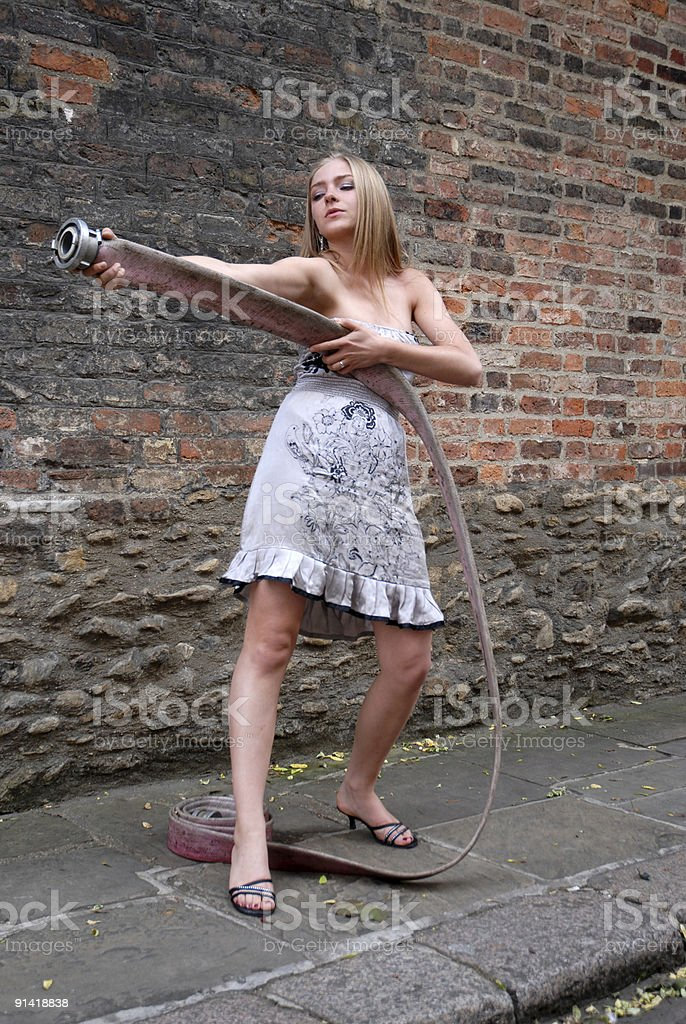 Girl with Fire Hose stock photo