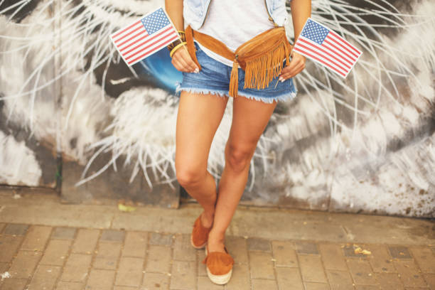 girl with flags - waist bag stock photos and pictures