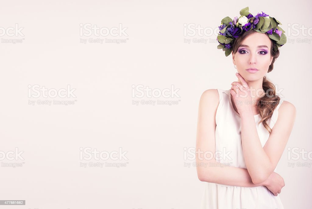 Girl with flower crown posing in studio stock photo