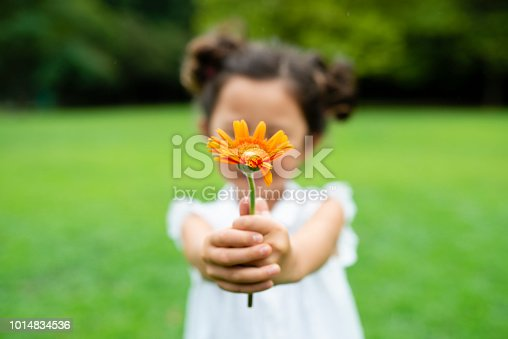 istock Girl with flower 1014834536