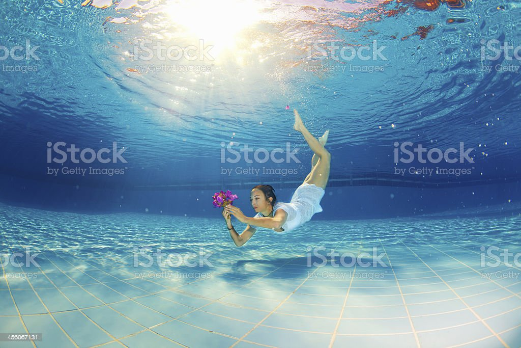 girl with flower underwater royalty-free stock photo