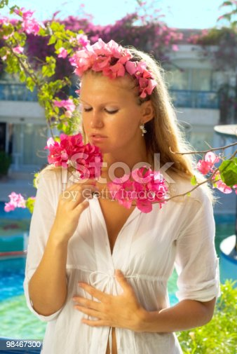 Girl With Flowers Stock Photo & More Pictures of Adult