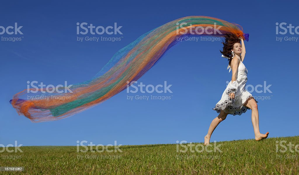 Girl With Flowing Fabric Running on the Hilltop Horizon royalty-free stock photo