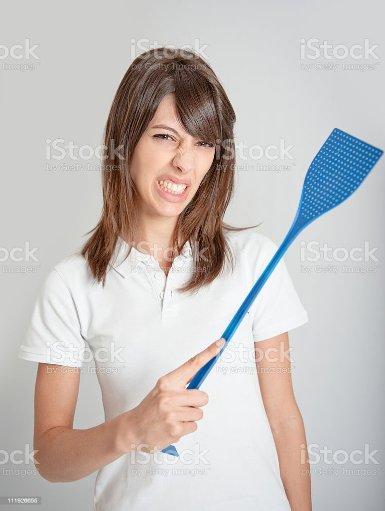 Girl with flyswatter stock photo