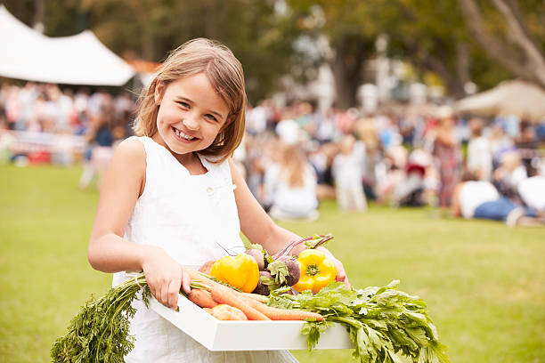 Girl With Fresh Produce Bought At Outdoor Farmers Market Girl With Fresh Produce Bought At Outdoor Farmers Markett, Smiling To Camera farmer's market stock pictures, royalty-free photos & images