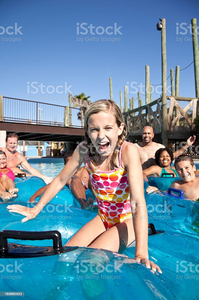 Girl with friends and family shouting at water park royalty-free stock photo