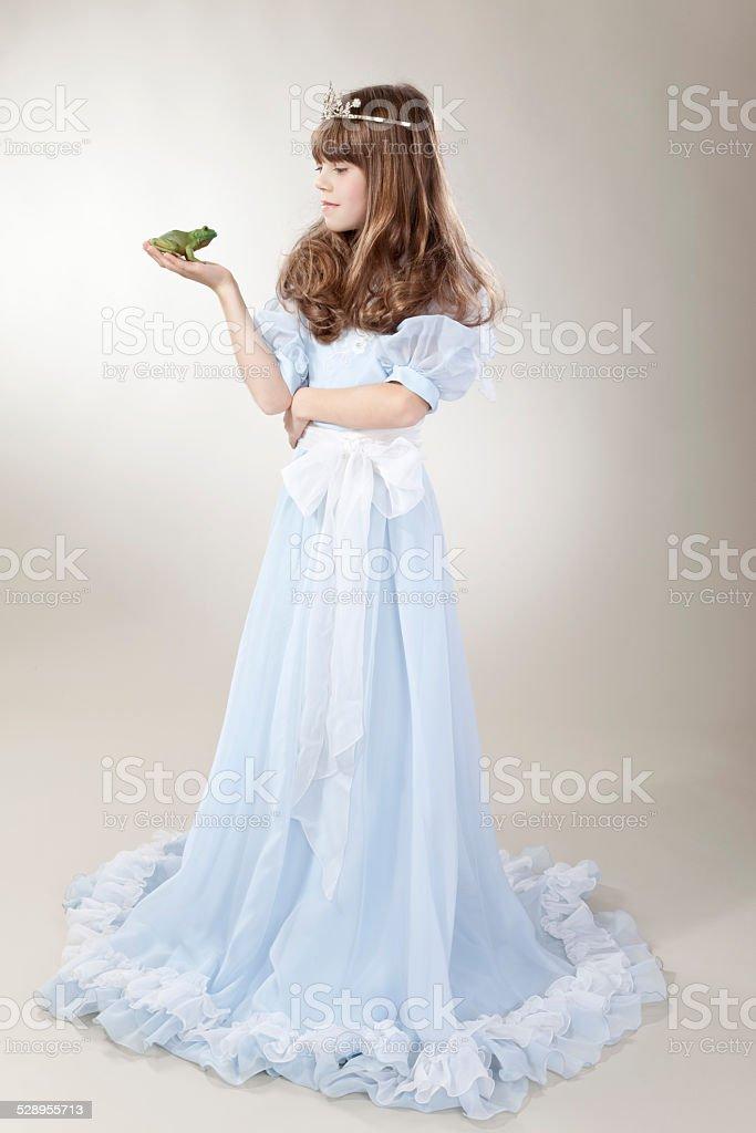Girl with frog king stock photo