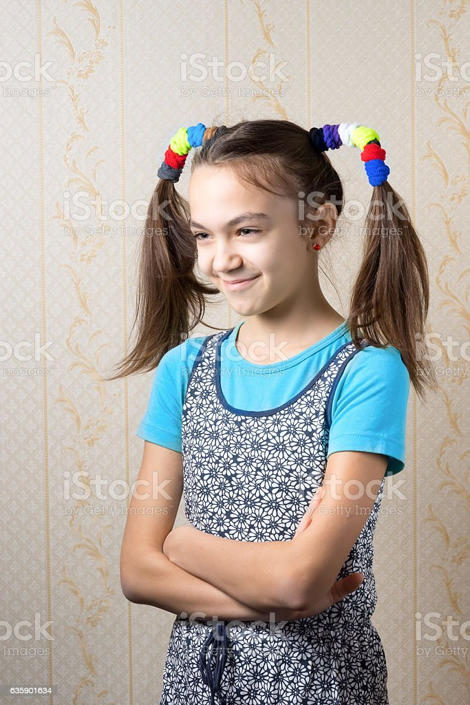 girl with funny tails standing with arms crossed. stock photo