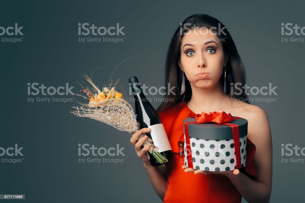 Girl with Gift Box, Wine Bottle and Flower Bouquet Ready for Party stock photo