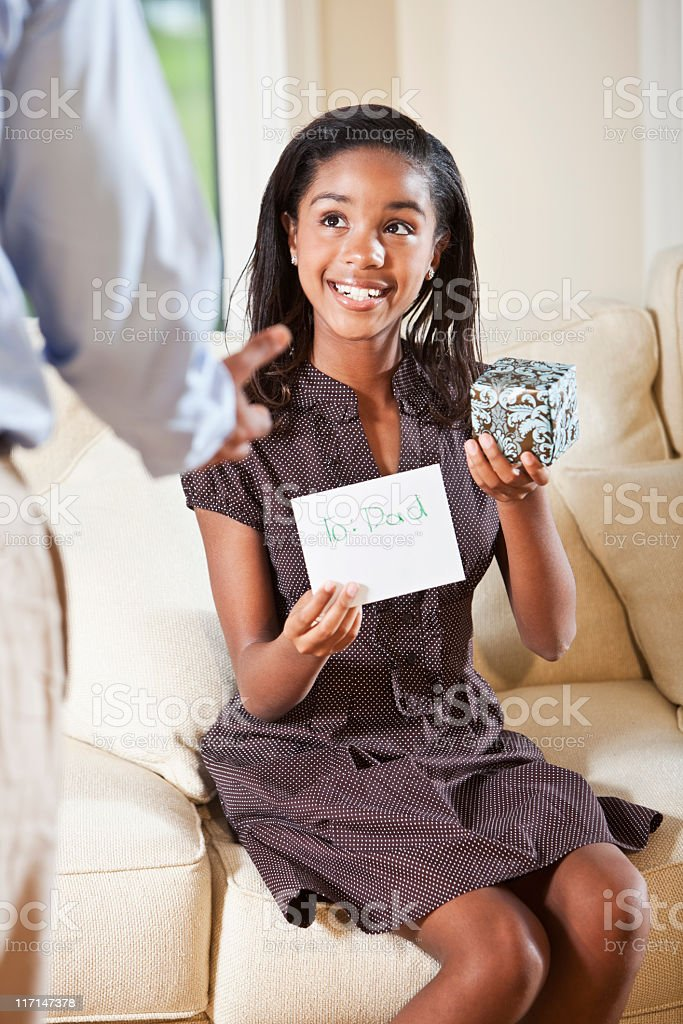 Girl with gift for dad stock photo
