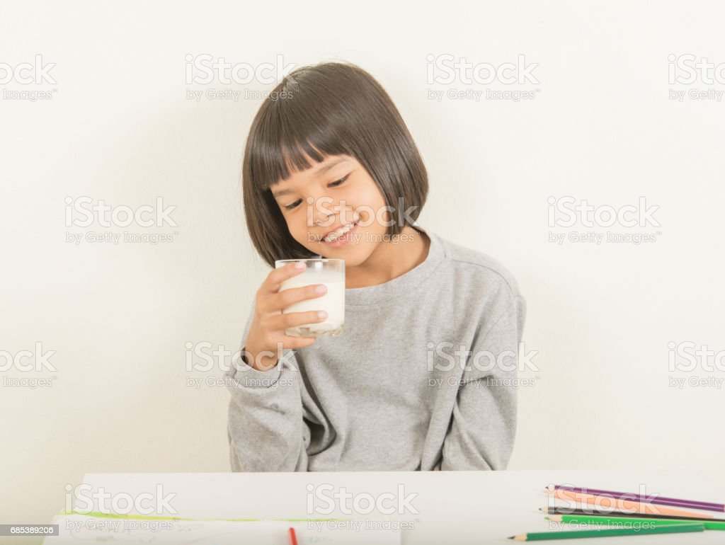 girl with glass milk on the wrist to table foto de stock royalty-free