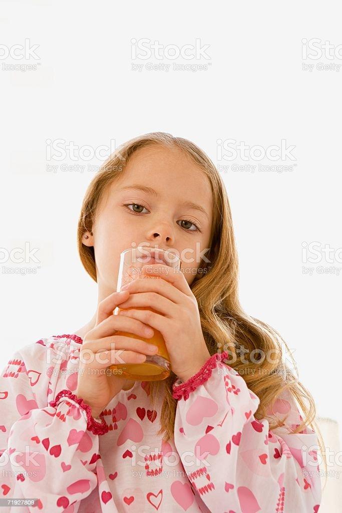 Girl with glass of orange juice royalty-free stock photo