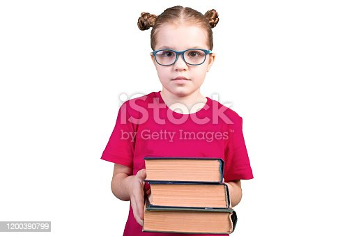 A girl with glasses holds a stack of old books. Isolated on a white background. For any purpose.