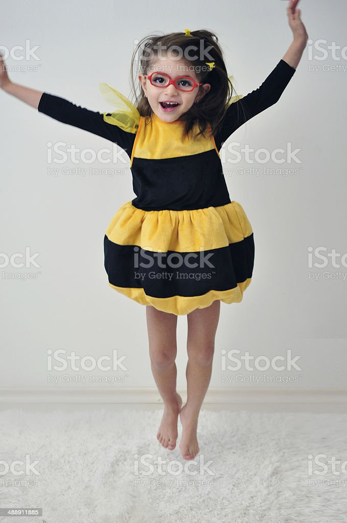 Girl With Glasses Like A Bee Jumping stock photo
