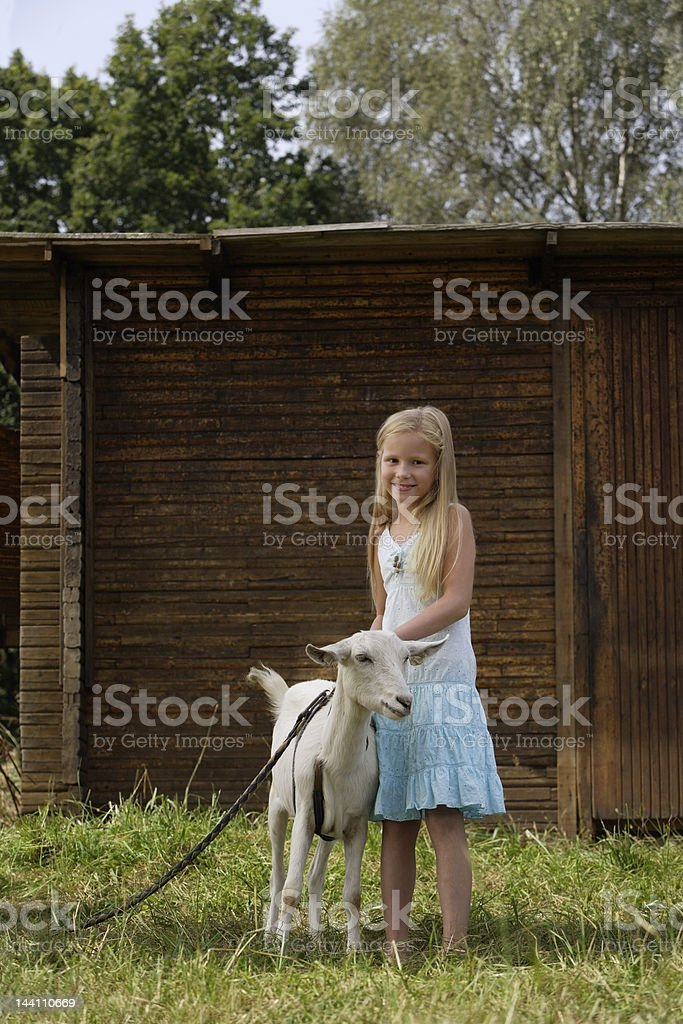 girl with goat royalty-free stock photo