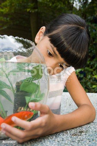 109350576 istock photo Girl with goldfish bowl 80469691