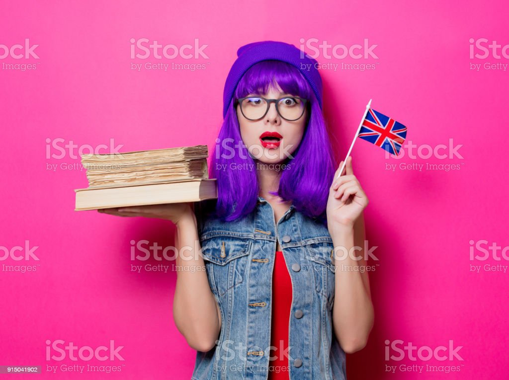 girl with Great Britain flag and books stock photo