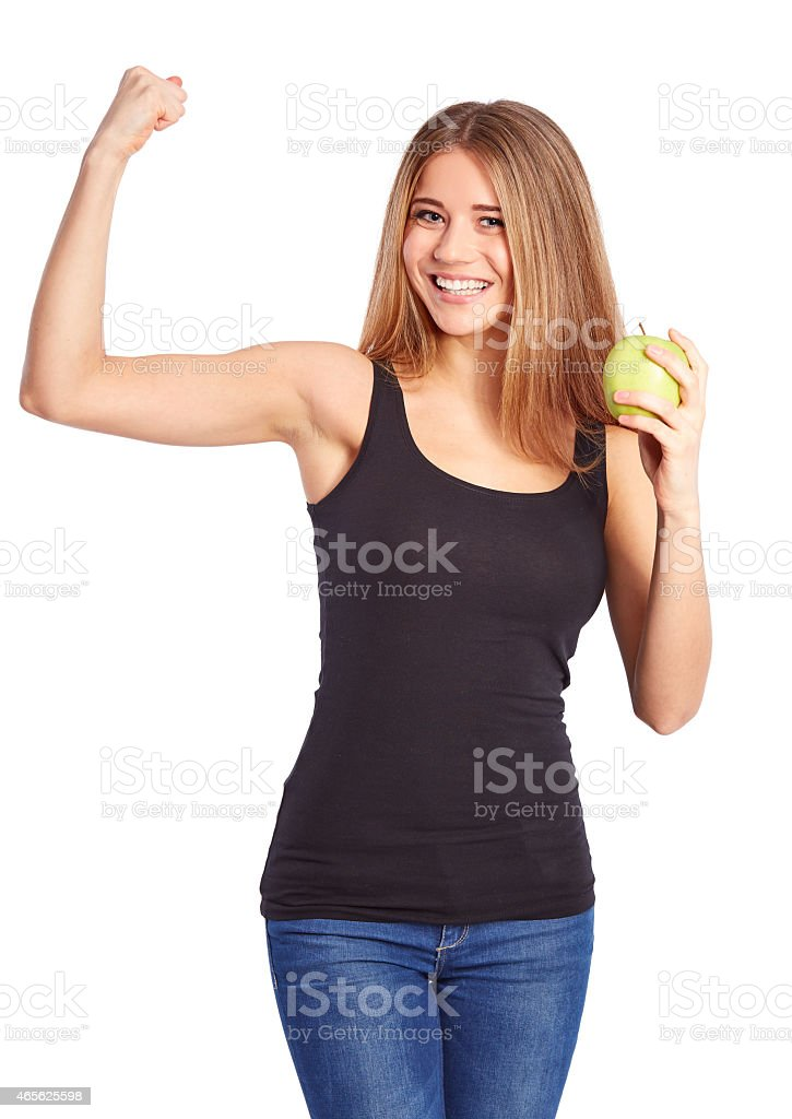Girl with green apple makes a gesture of force stock photo