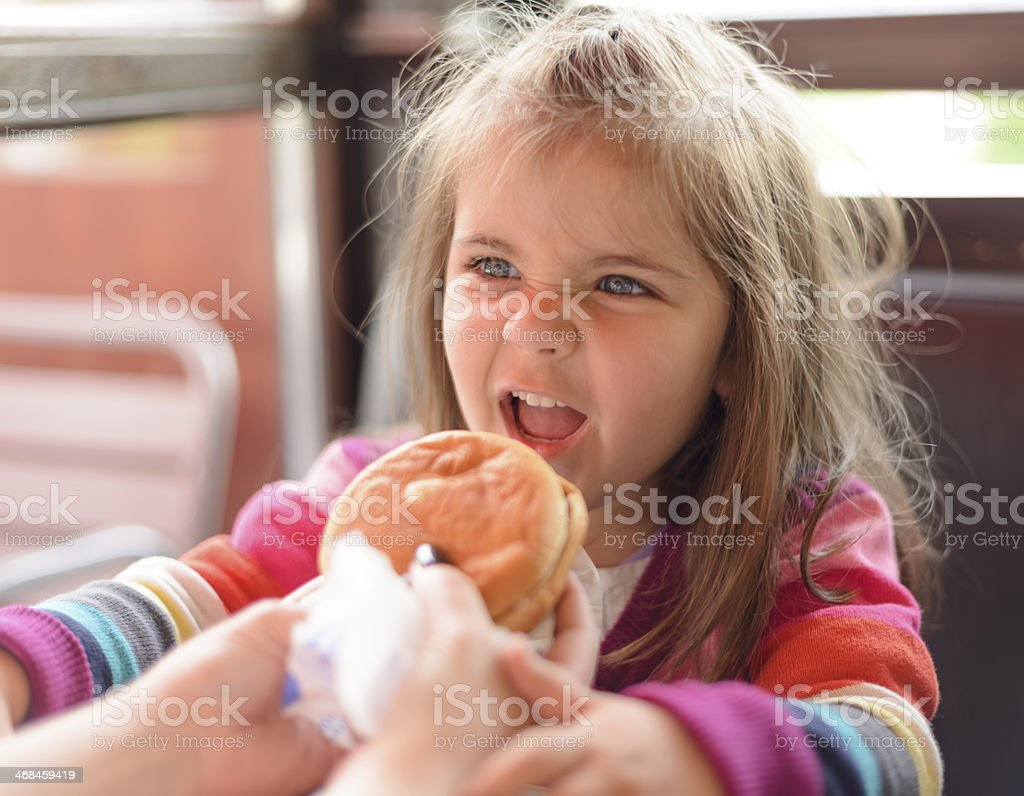 girl with hamburger royalty-free stock photo