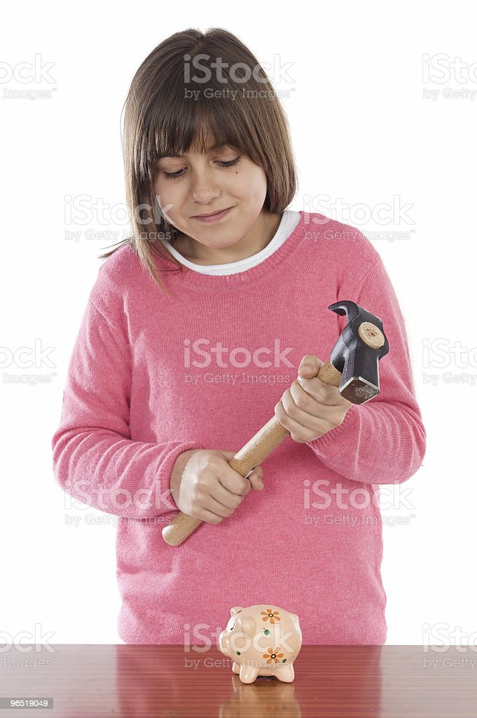 Girl  with hammer and money box royalty-free stock photo