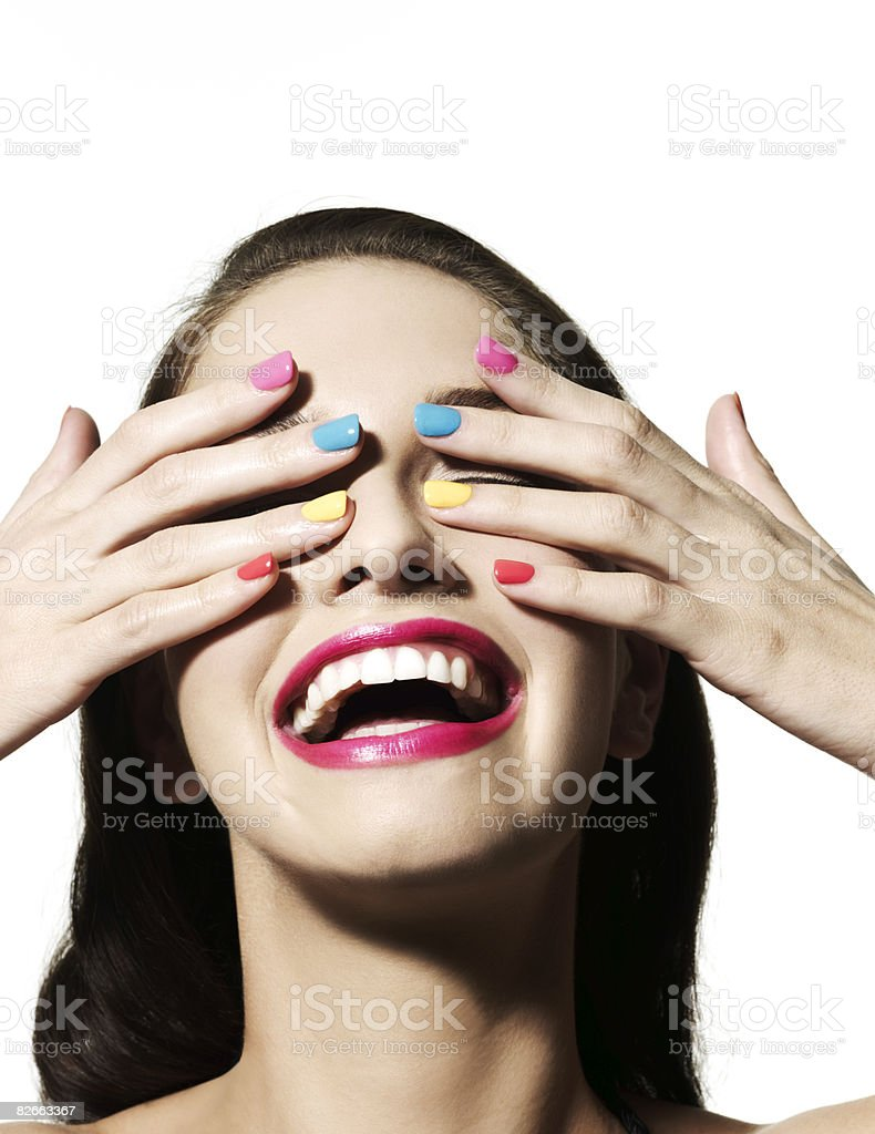 Girl with hands over her eyes stock photo